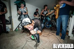 Photos: Molly Rhythm playing a basement show in Montreal